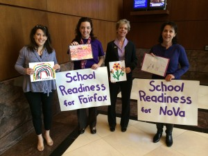 Supporters present art created by local preschoolers during the Fairfax public budget hearing.