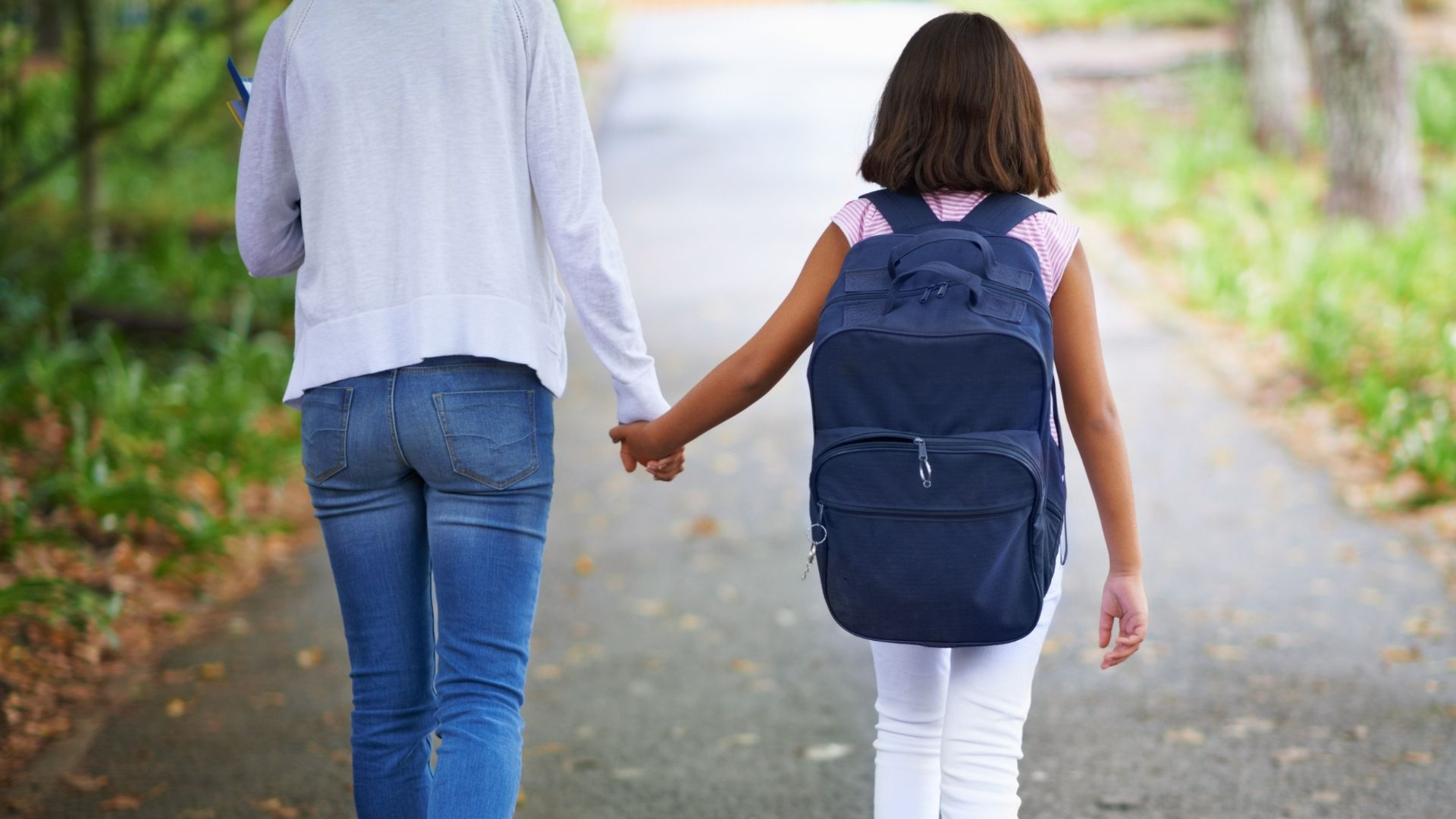 Adult walking with child